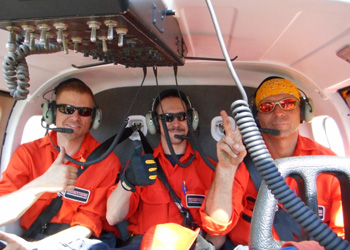 Crew posing in helicopter employment