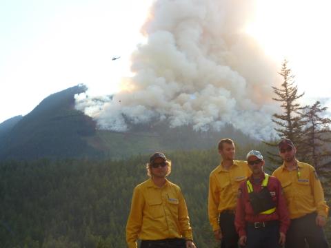 Firestorm Team Posing Behind Fire